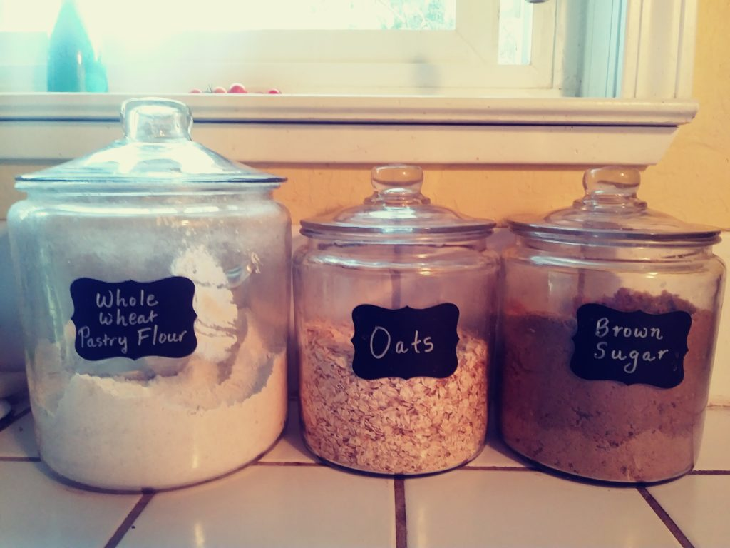 My glass canisters with flour, sugar and oats
