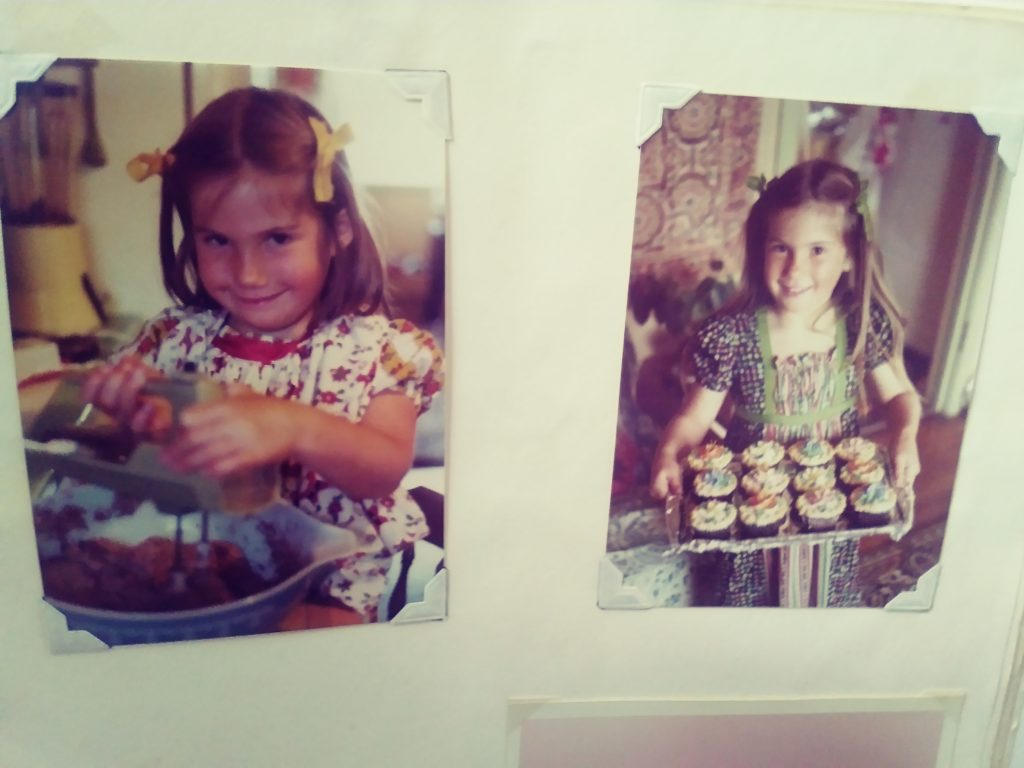 Photos of me at age 5 holding a mixer and making cupcakes and holding a tray of cupcakes with flower decorations