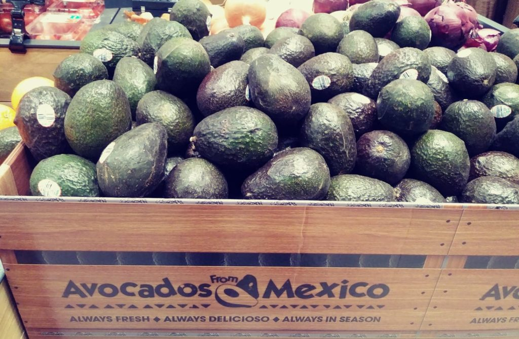 bin of avocados from Mexico