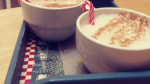 homemade soy lattes on a tray with candy canes
