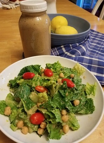Caesar salad in a bowl with tomatoes and chickpeas