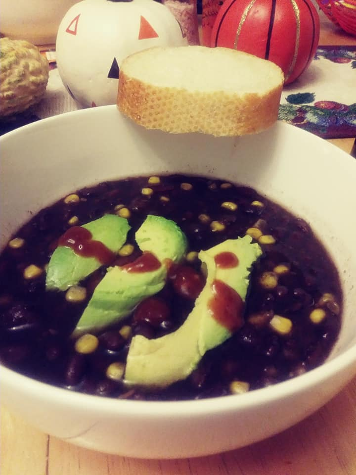 black bean soup with avocado slices