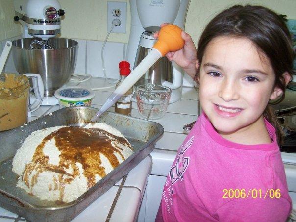 my daughter basting the tofu turkey