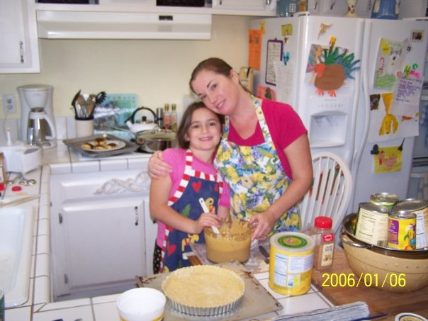my daughter and I making Thanksgiving food together in my kitchen