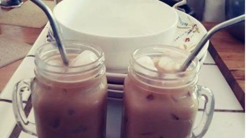 Iced coffee in mason jar cups