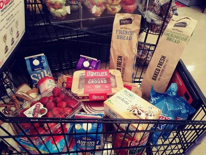 Grocery cart filled with vegan groceries