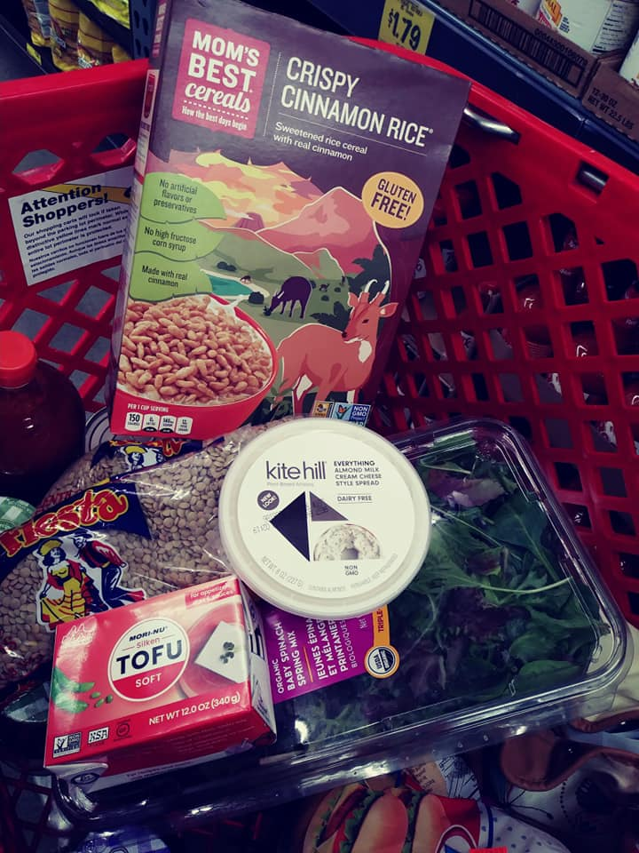 Grocery Outlet cart with Mom's cereal, Kite Hill cream cheese, silken tofu, lentils and salad pak