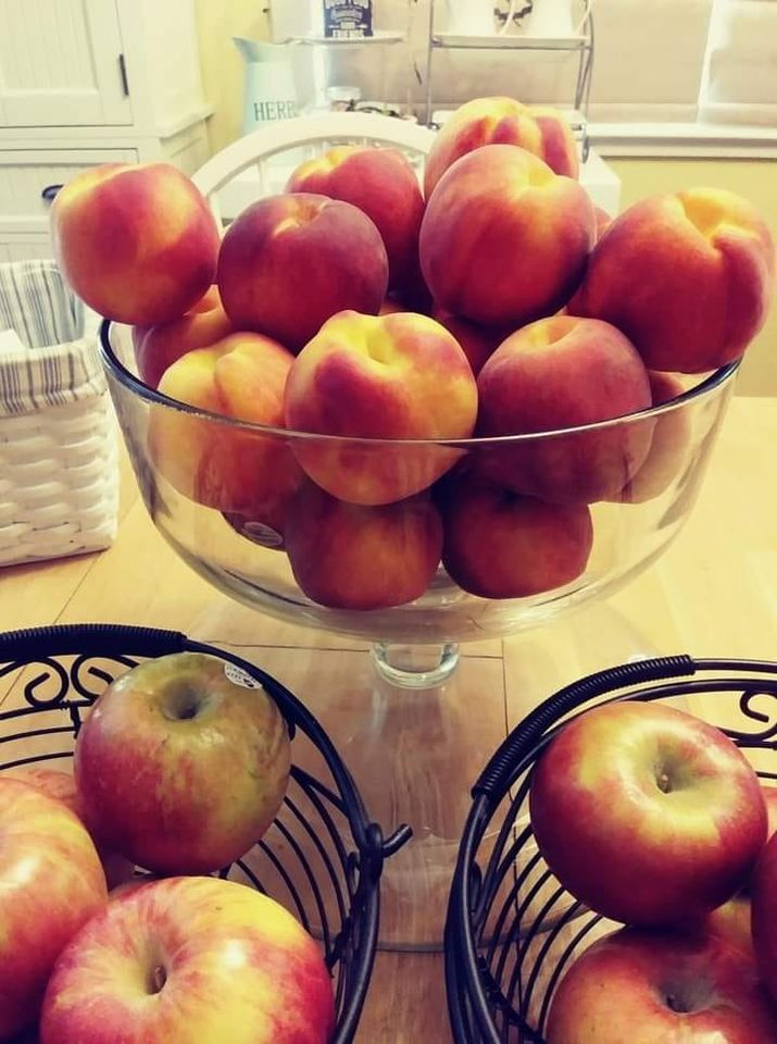 Peaches & Apples in decorative glass and metal containers