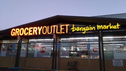 Grocery Outlet Sign on Storefront at Night