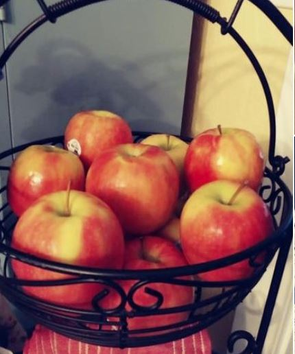 Apples in a black wire basket