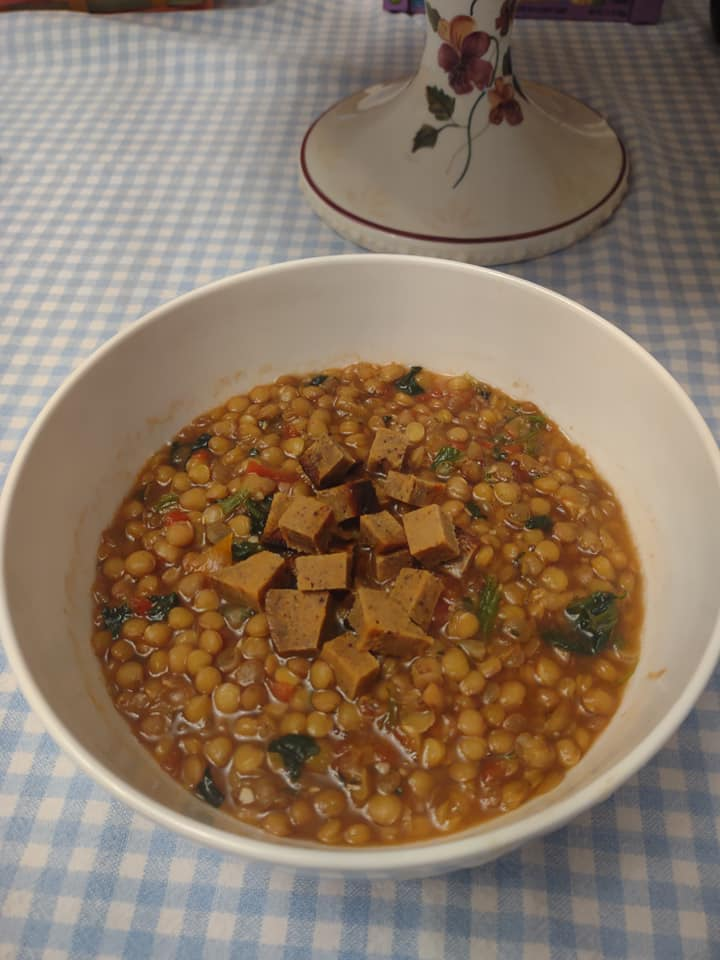 Bowl of homemade Indian Lentil Soup with vegan ham