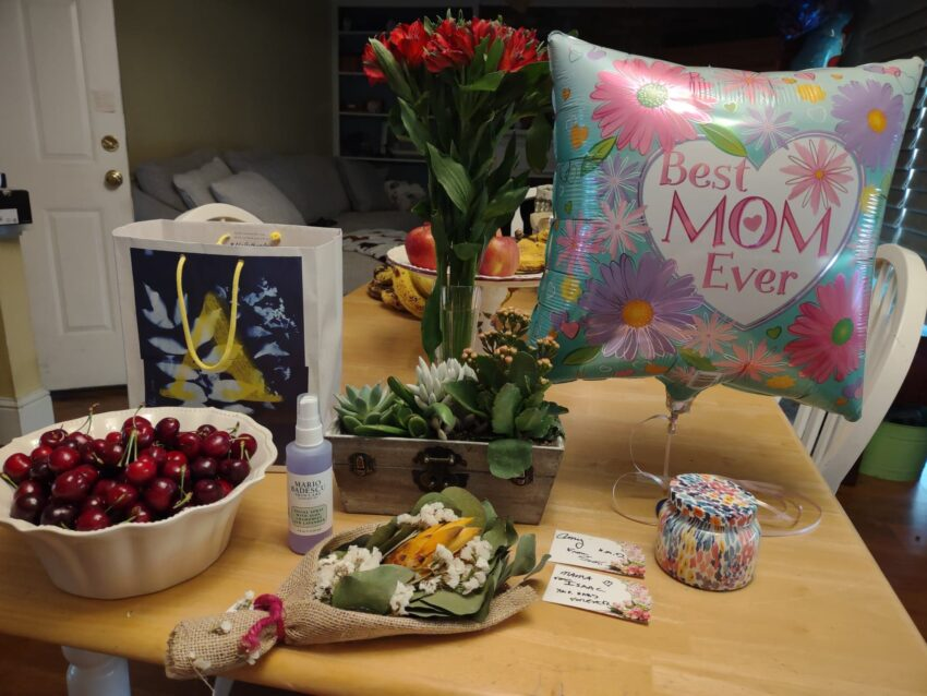 My Mother's Day Gifts: flowers, balloon, cherries, face spary, succulents and a candle