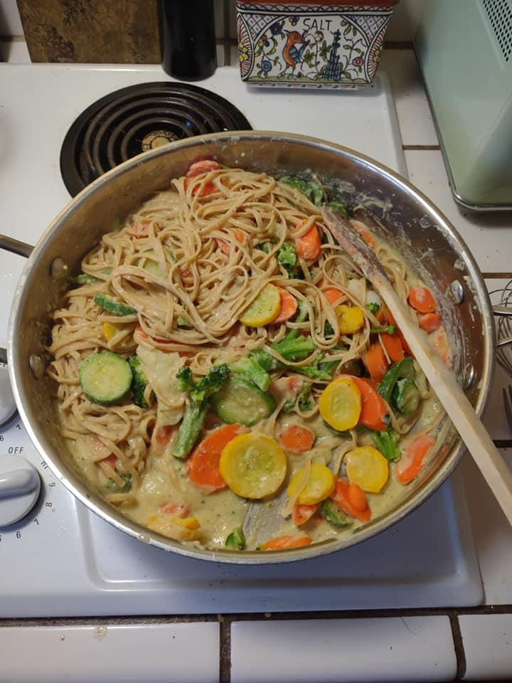 Pasta creamy garlic sauce in skillet