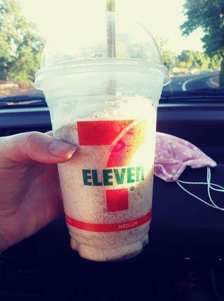 Me holding Slurpee cup