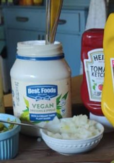 Vegan condiments: Best Foods vegan mayo and Heinz catsup and diced onions on a tray