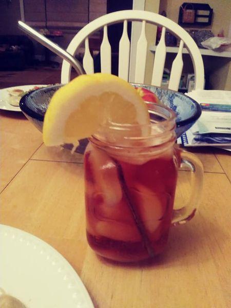 iced tea with lemon slice homemade in a mason jar cup