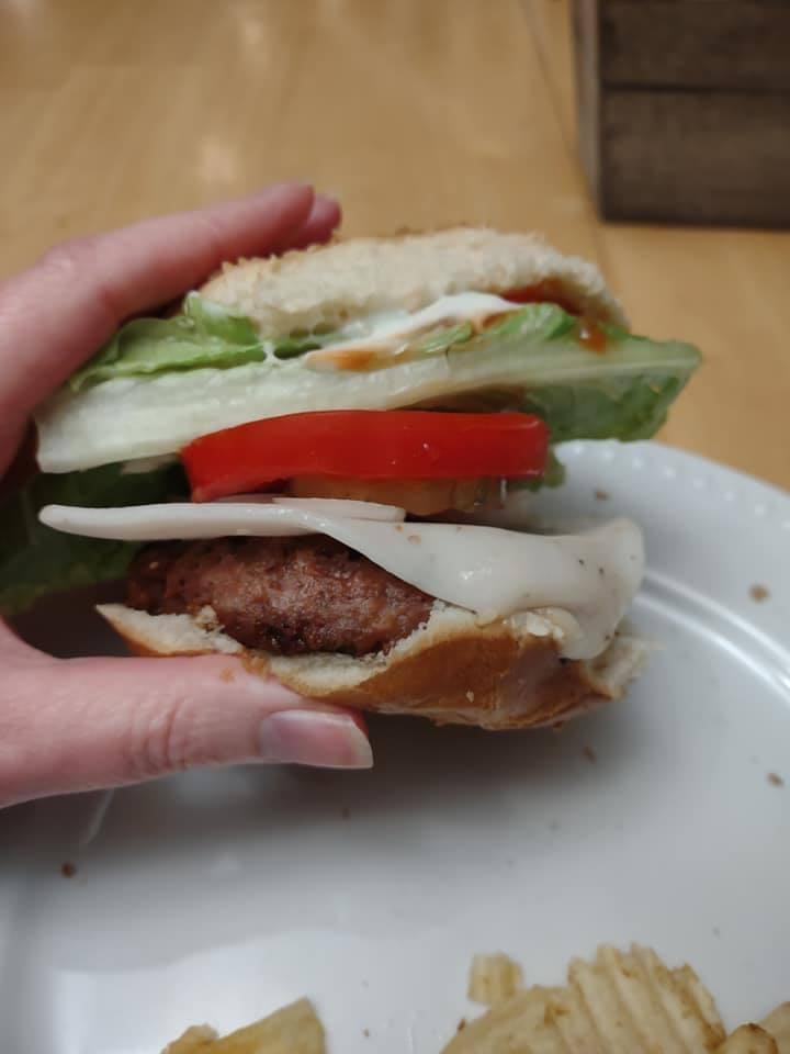 Beyond burger on bun with fixins'