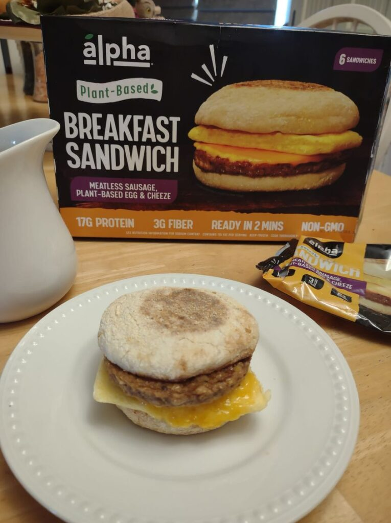 Alpha breakfast sandwich on plate and box behind
