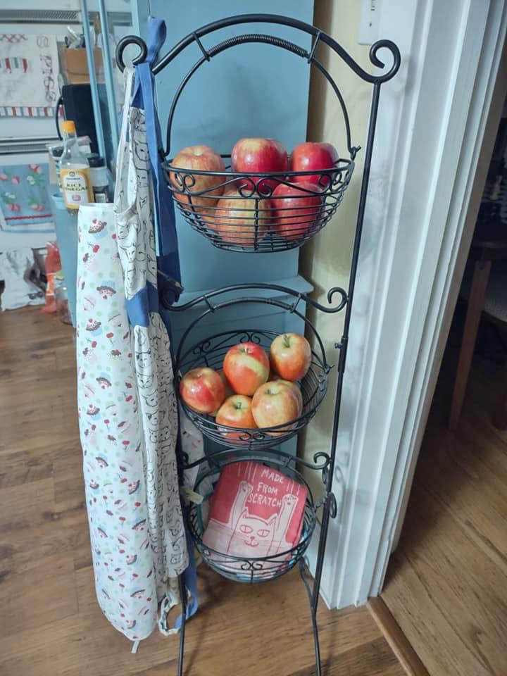 apples in 3 tiered wire basket wire basket